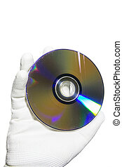 Hand in a white glove holding the compact disc CD