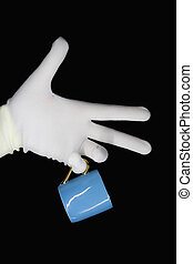 Hand in a white glove with a blue cup
