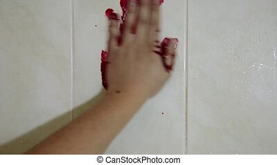 Hand in blood on a wall