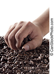 hand in coffee beans
