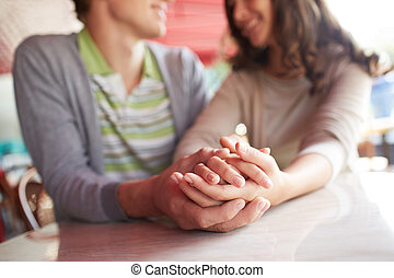 Hand in hand - Close-up of hands of romantic couple