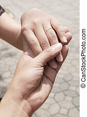 Hand-in-hand. Couple love