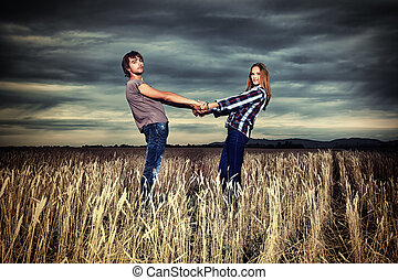 hand in hand - Romantic young couple in casual clothes...