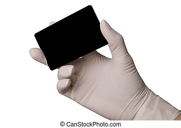 Hand in latex medical glove holding a credit card