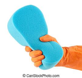 Hand in orange glove with sponge
