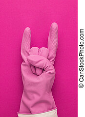 hand in pink protective glove shows horns gesture. cool...