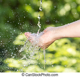 hand in the water in nature