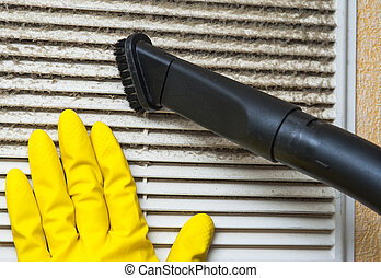 Hand in yellow glove and vacuum cleaner pipe. Ventilation...