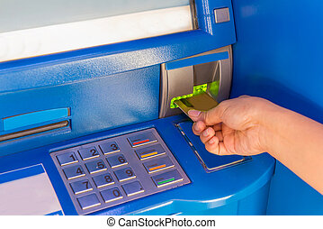 Hand insert credit card to ATM bank cash machine for ...