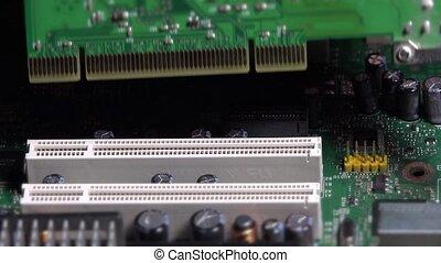 Hand insert pci card into motherboard slot on desktop...