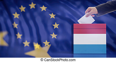 Hand inserting an envelope in a Luxembourg flag ballot box ...
