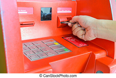 Hand inserting ATM card