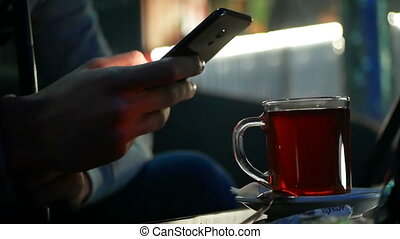 Hand internet drinking tea