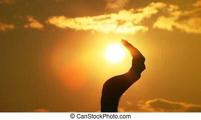hand irons the sun