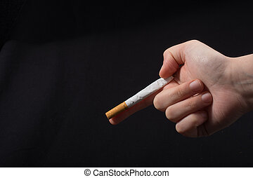 Hand is holding a cigarette like gun