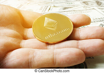 Hand is holding coin ethereum ETH under dollar banknotes. ...