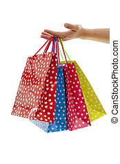 Hand is holding colorful shopping bags