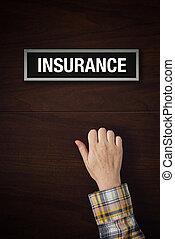 Hand is knocking on Insurance door
