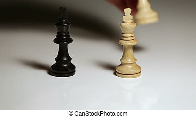 Hand is setting up a chess figures