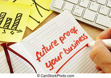 Hand is writing future proof your business.