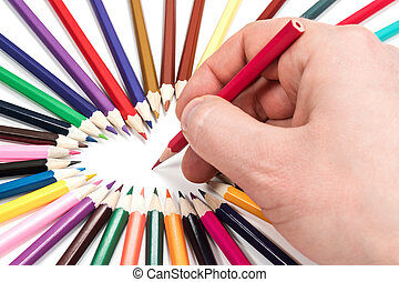 Hand is writing with a pencil