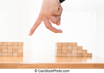 Hand jump through the gap between wood block, Jump over obstacles concept