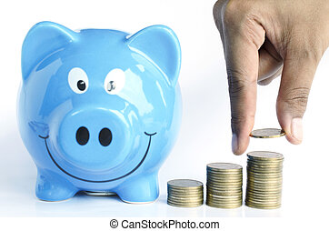 Hand keeping coins and coin stcak and blue piggy bank on white backgrounds