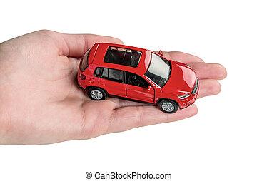 hand keeps model of a car