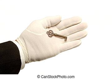 Hand & KeyHand & Key - White Gloved hand holding Key