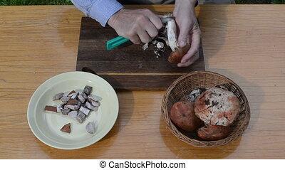 hand knife clean mushroom - man hands clean dirt from fresh...