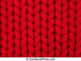 Closeup showing purl stitch. Red acrylic wool.