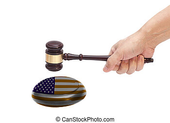 Hand knocking a Judge gavel at soundboard with USA flag