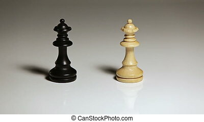 Hand knocking over chess piece - Close up of single hand...
