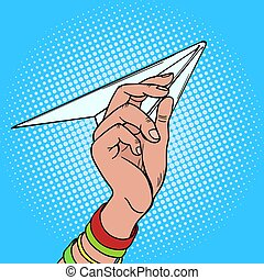 Hand launches paper airplane pop art vector