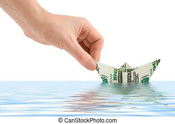 Hand launching money ship isolated on white background