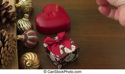 Hand lighting christmas candle