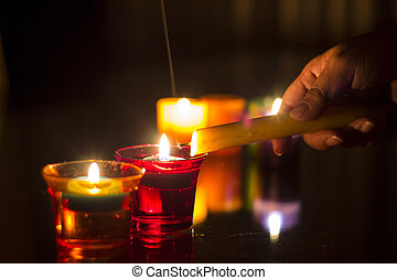 Hand lighting the candles