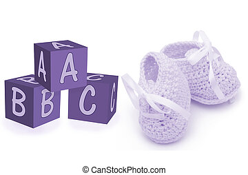 Hand-made baby booties and blocks