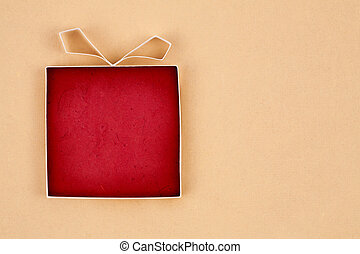 Hand made empty gift box, textured paper as background. Free space for text. Greeting card