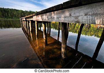 Hand made pier on lake close up