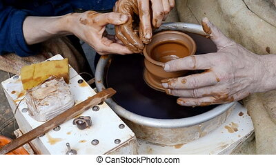 hand made pottery - manufacturing pitcher hands on a...