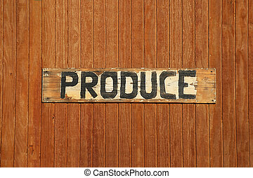 Hand-made Produce Sign - Hand-made produce sign on a wood...