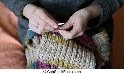 Hand made scarf - Woman hands knitting wool scarf, closeup...