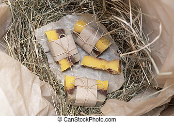 Hand made soap on the dry grass in the box