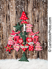 Hand made traditional christmas decoration on wood