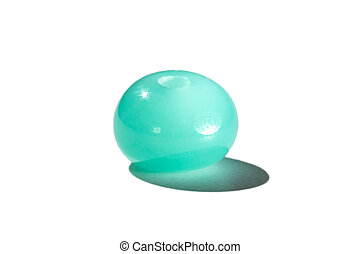 Hand made turquoise glass bead on white background