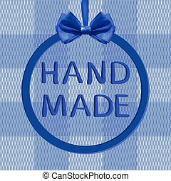'Hand made' VECTOR text in frame with realistic blue bow on textile texture.