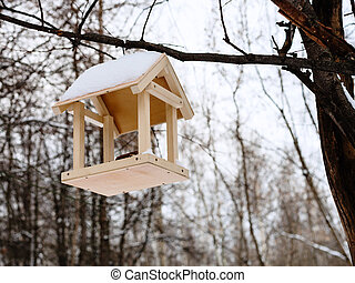 birdfeeder on tree branch in woods in winter - hand made...