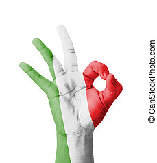 Hand making Ok sign, Italy flag painted as symbol of best...