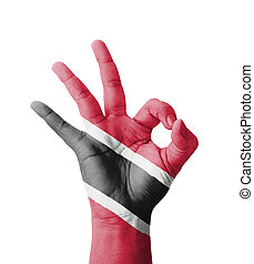 Hand making Ok sign, Trinidad and Tobago flag painted as...